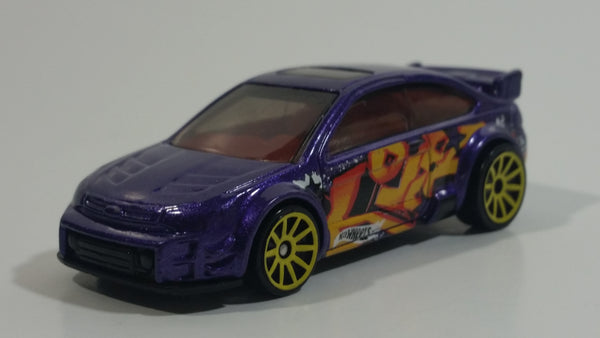 2015 Hot Wheels Graffiti Rides '08 Ford Focus Purple Die Cast Toy Car Vehicle