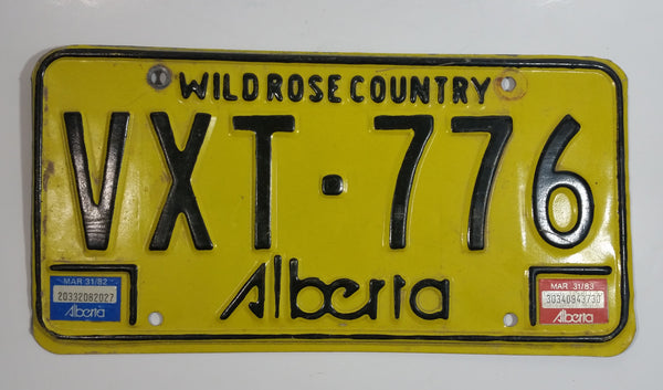 Vintage 1980s Alberta Wild Rose Country Yellow with Black Letters Passenger Vehicle Metal License Plate Tag VXT - 776