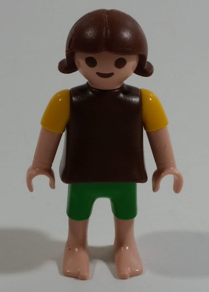 "Geobra Playmobil Brown Haired Girl Green Shorts Brown Top Yellow Sleeves 2"" Tall Toy Figure"