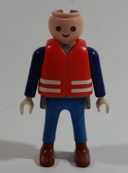 "1993 Geobra Playmobil No Hair Man in Blue Bottoms Grey Top Dark Blue Sleeves Covered with Life Preserver Jacket 3"" Tall Toy Figure"