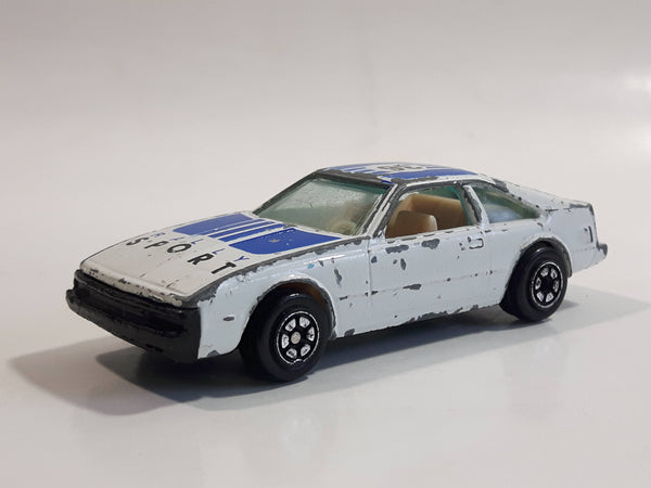 Vintage Yatming Toyota Celica Flying Engine #36 No. 1036 White Blue Rally Sport Die Cast Toy Race Car Vehicle