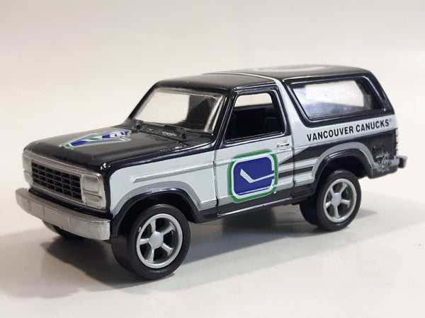VHTF 1999 Racing Champions '80 Ford Bronco NHL Vancouver Canucks Ice Hockey Team Dark Blue and White Die Cast Toy Car Vehicle