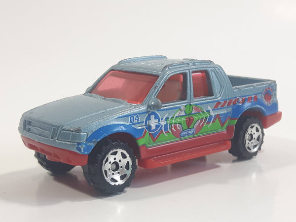 2004 Matchbox Medic Rescue Ford Explorer Sport Trac Pickup Truck Metalflake Light Blue Die Cast Toy Car Vehicle
