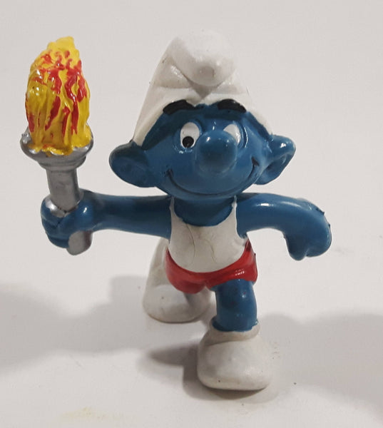Vintage 1979 Peyo Smurf Character Olympic Athlete Running with Torch PVC Toy Figure