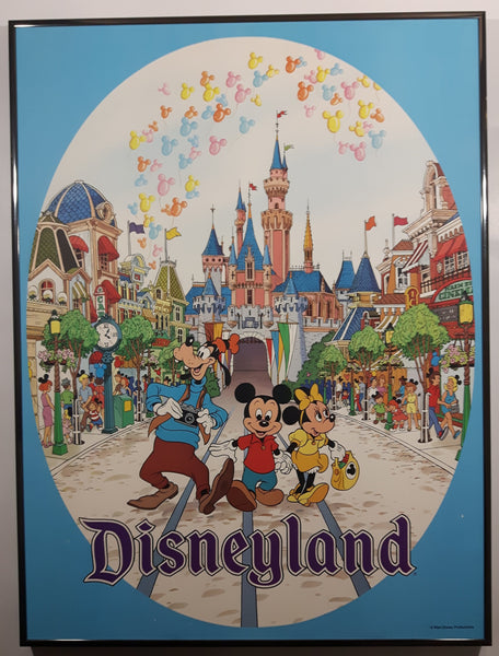 "Walt Disney Productions Disneyland Goofy, Mickey Mouse and Minnie Mouse On Street with Castle Behind Them Large 18"" x 24"" Framed Hardboard Poster"