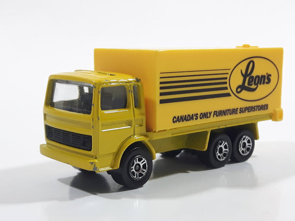 Majorette Leon's Canada's Only Furniture Superstores Semi Truck Yellow 1/100 Scale Die Cast Toy Car Vehicle with Opening Rear Doors