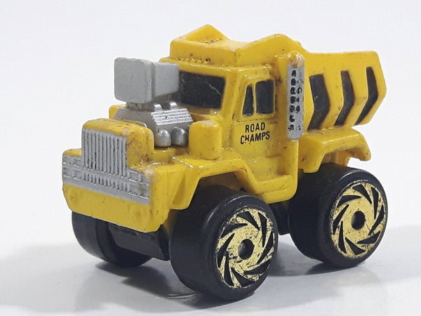 1987 Road Champs Dump Truck Yellow Micro Mini Die Cast Toy Car Construction Vehicle