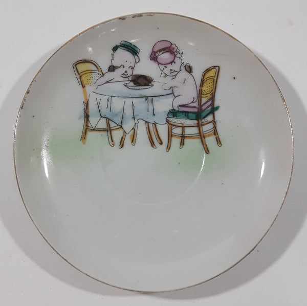 "Vintage Occupied Japan Style Chubby Male and Female Nude Naked Cherub Like Characters Sitting At A Table 4 1/4"" Diameter Hand Painted Porcelain Plate"