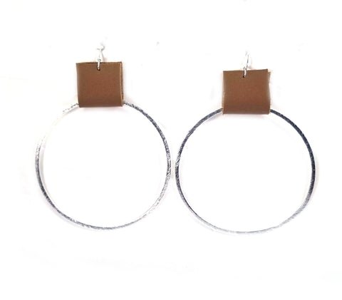 Brushed gold or silver hoop earrings with leather accents--3 sizes