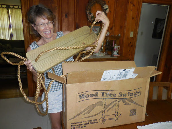 Happy customer getting a Wood Tree Swing