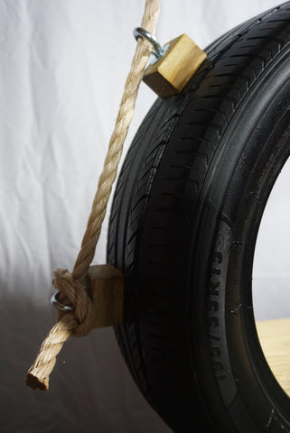 Image of Recycled, Old-Fashioned Tire Swing Rope Detail