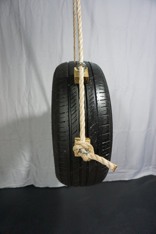 Image of Recycled, Old-Fashioned Tire Swing Full Side