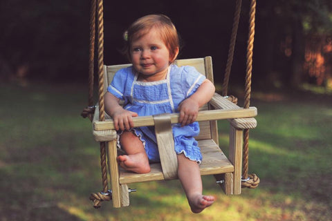 Toddler enjoying the Toddler Swing