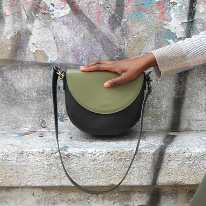 Black Leather Saddle Bag with Light Olive Green Half-moon Flap