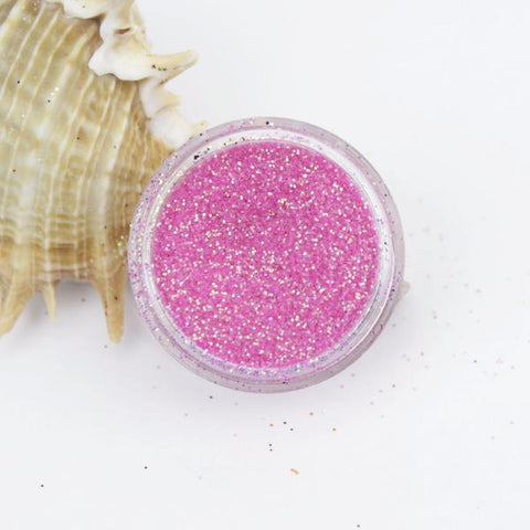 evol translucent iridescent fierce pink dust face glitter
