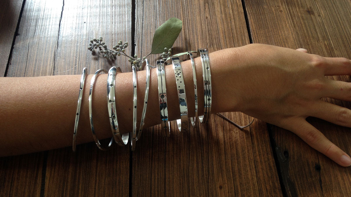 A few bangles around a woman's wrist.