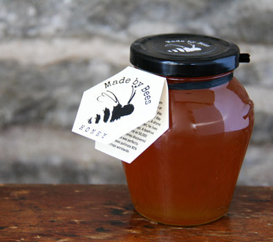 A jar of Made by Bees amber coloured honey