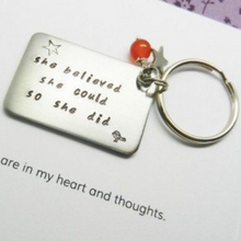 "Graduation Keyring hand stamped with ""She believed she could, so she did'"