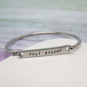 Personalised bangle with 'soul sister' hand stamped on it