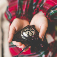Sleigh Bell in a child's hands