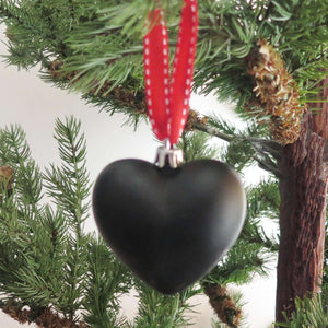 Chalkboard Christmas Tree Decoration hanging on a tree branch