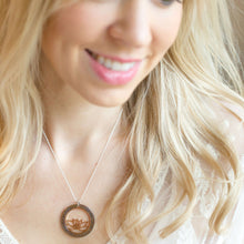 Inspirational Lotus Necklace on smiling model