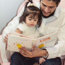 Man wearing Personalised Leather Bracelet reading to his daughter