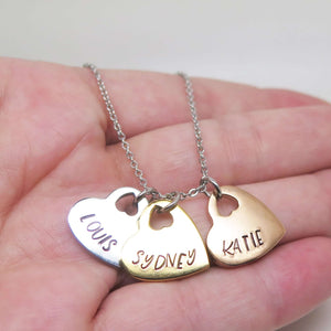 Personalised Three Heart Necklace in a Hand
