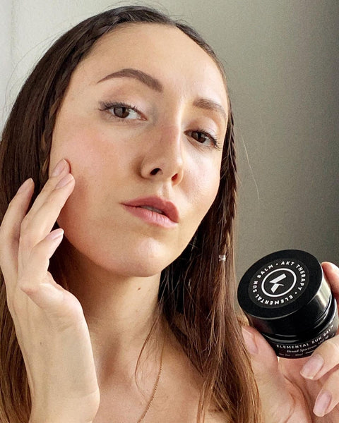 Luisa C applying AKT Therapy's Elemental Sun Balm, a mineral sunscreen