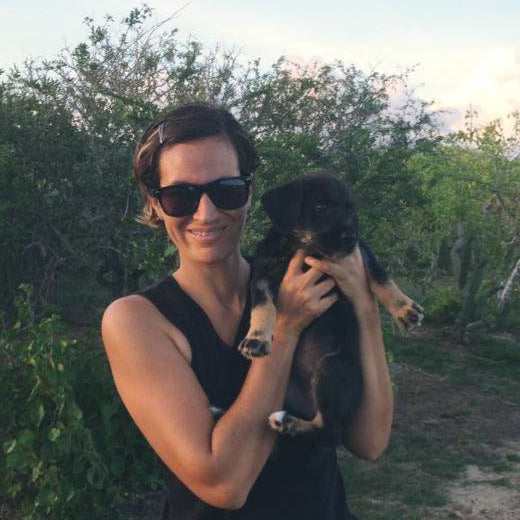 Mariana with a puppy from Dog Prana Outreach
