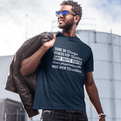 "a petrolhead is wearing ""car guys problems"" car t-shirt made for car guys, JDM t-shirt, a cool t-shirt made for drifters and car lovers, funny car t-shirt, muscle car guys, made in the USA, excellent quality print, free shipping, sale 40% off,  car enthusiasts love it, navy blue color"
