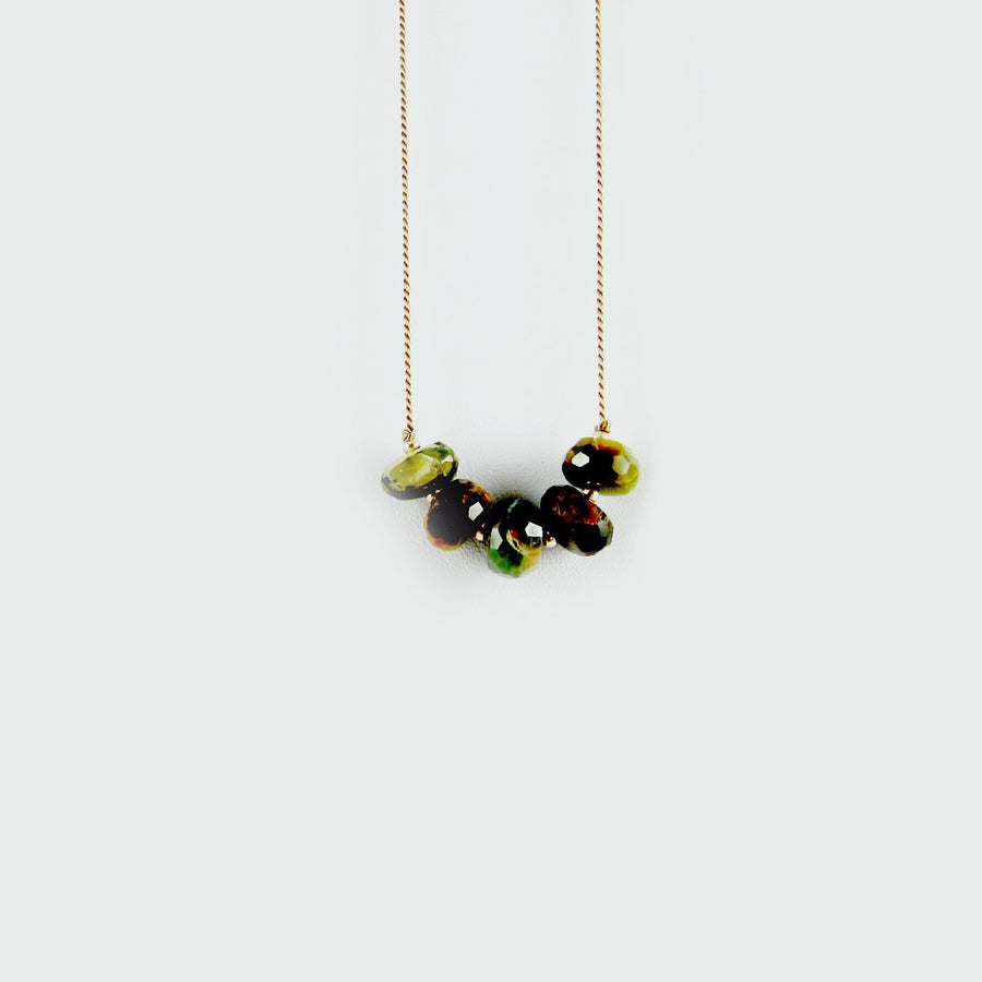 5 faceted rondelle Cats eye chrysoberyl hang from a beige silk cord necklace.  Perfect for Fall!