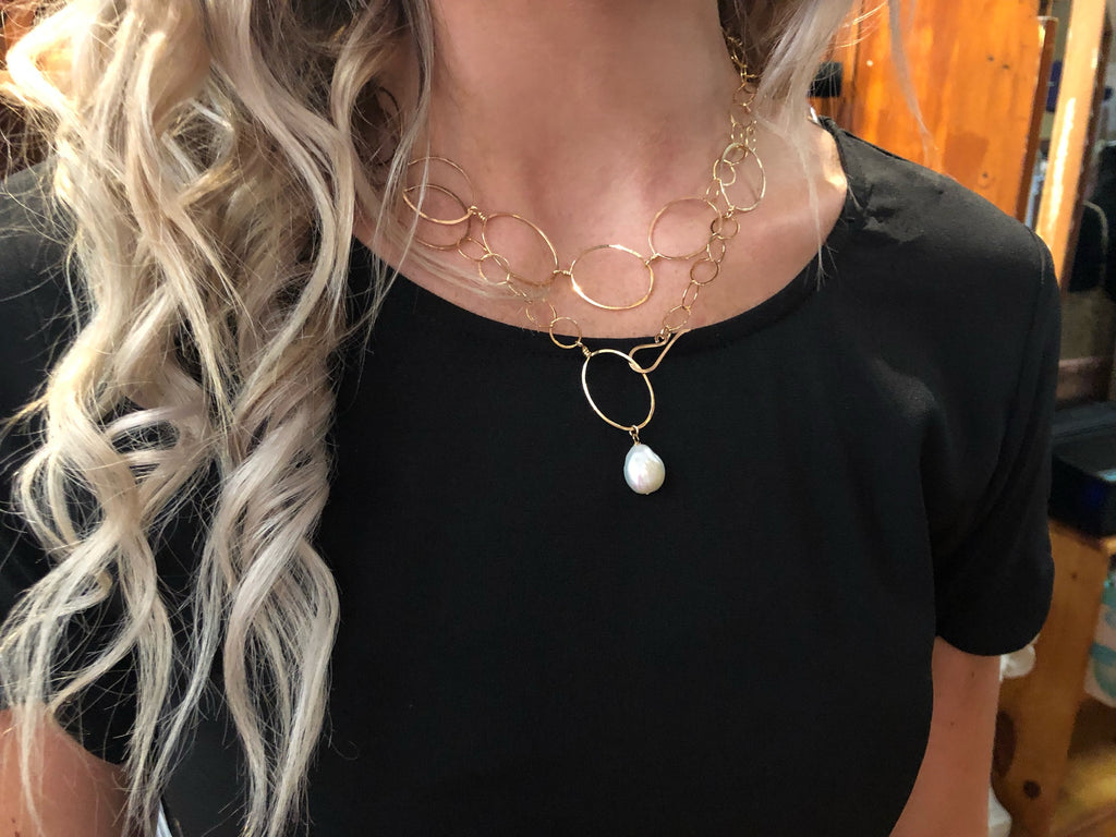 "Model wearing 14k GF forged oval and chain necklace-36"" length (shown styled as wrapped double around her neck)"