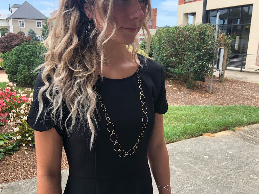 "Model wearing 14k GF forged oval and chain necklace-36"" length"