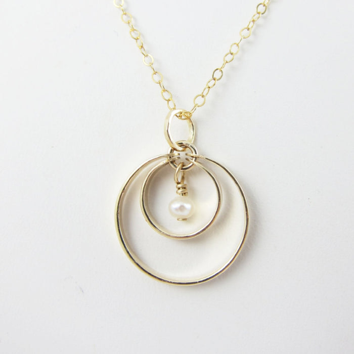 14K Gold Forged double circle necklace with pearl center