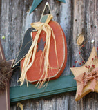 Hand made pumpkin crow wall hanging.