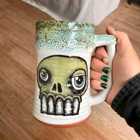 Green Skull Stein with Yellow, Blue, and Black Lip Drip