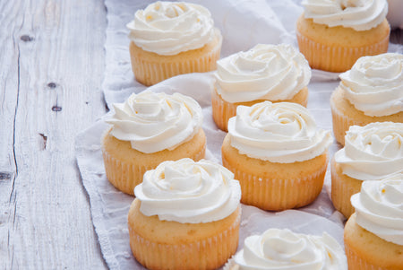 How to make Vanilla Cupcakes with Lemon Cream Cheese Frosting.