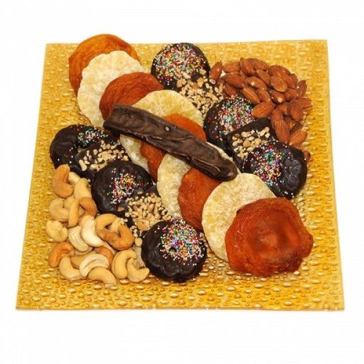 Tu B Shvat Glass Plate Filled With Dry Fruits and Chocolates