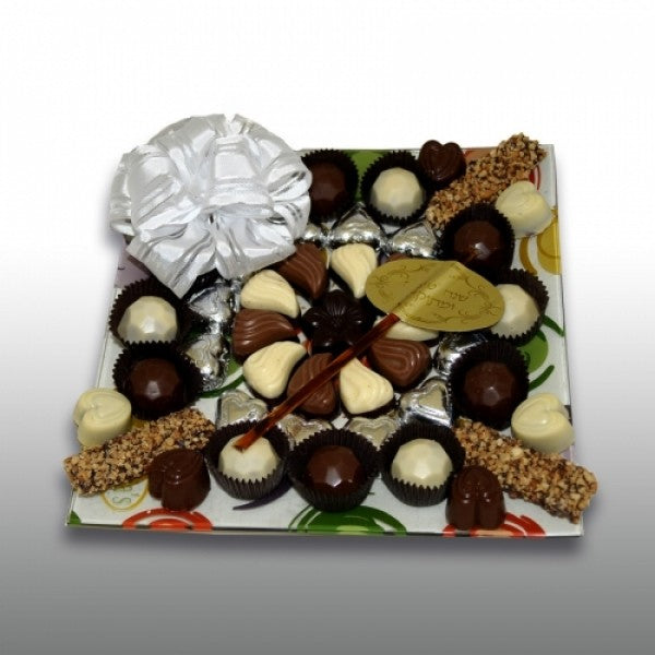Designers Glass Tray Filled With Chocolates And Honey