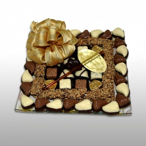 Designers Glass Tray Filled With Chocolates And Honey Straw