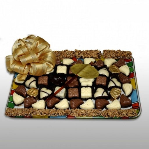 Prolonged Rectangular Glass Tray Filled With Chocolates And Truffles