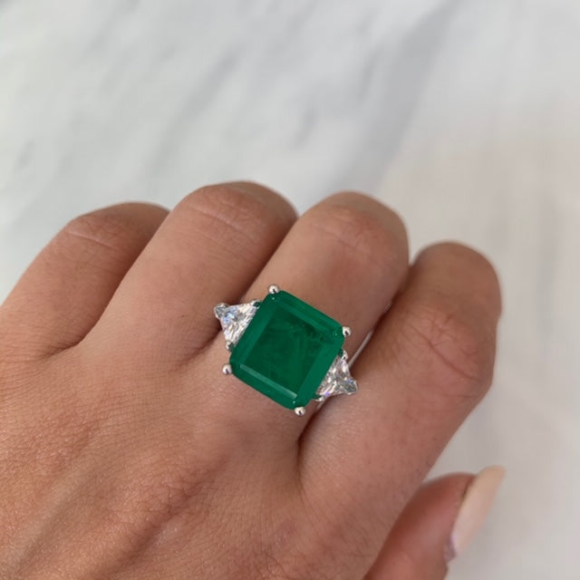 Sterling silver Emerald green ring with triangle cut side stones