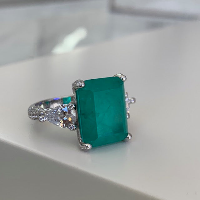 Sterling silver Paraiba ring with pear shaped side stones