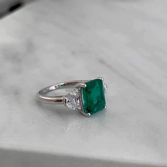Sterling silver Emerald green ring with cushion cut side stones