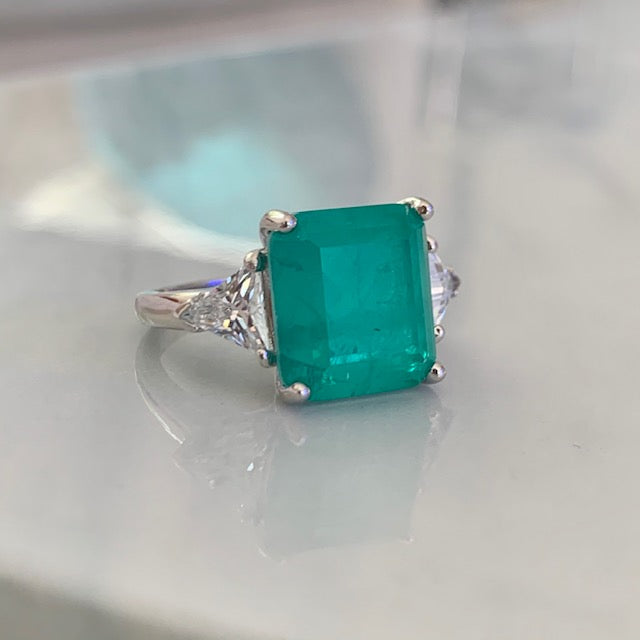Sterling silver paraiba ring with triangle cut side stones