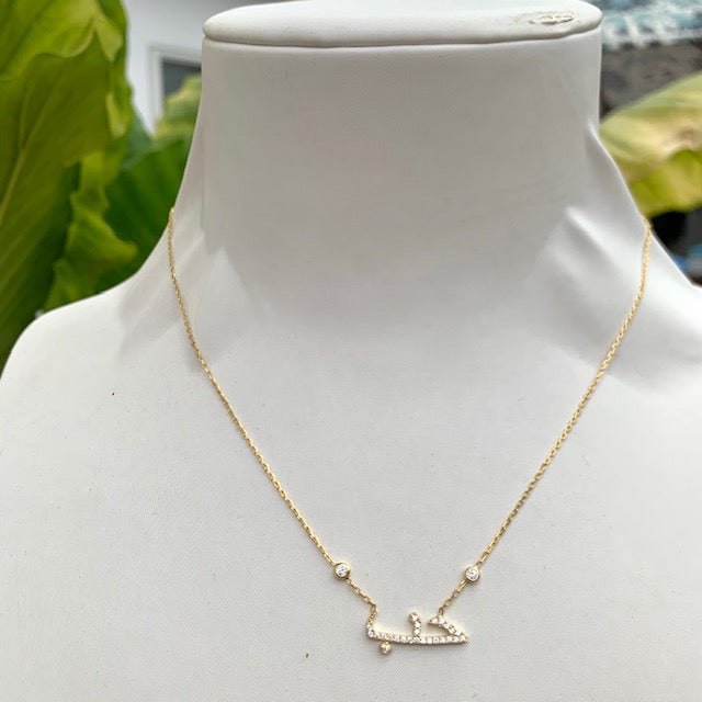 """Love"" gold necklaces"