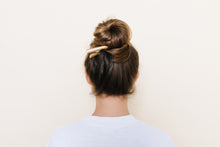 Golden Blonde TopBun hair clip shown holding a high bun in brunette hair