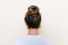 Dark brown TopBun hair clip shown holding a high bun in brunette hair