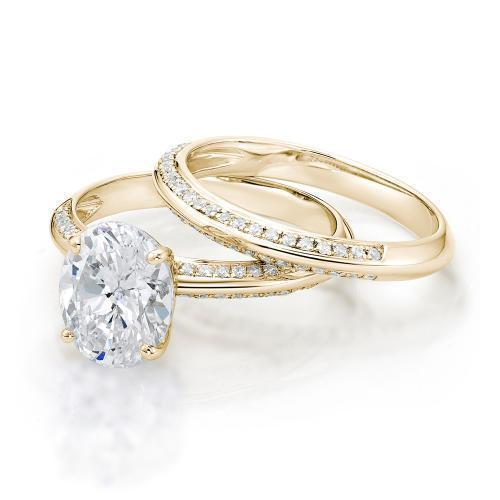 Oval Cut Knife Edge Engagement Ring and Band Set in Yellow Gold